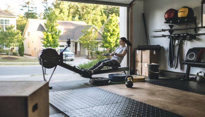 active-woman-exercising-on-a-rowing-machine-in-her-royalty-free-image-1607437786